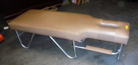 Tan Upholstered Treatment Table