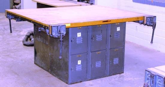 LARGE WORK TABLE WITH 4 VISES AND 12 LOCKERS UNDERNEATH