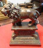 LION ON A PEDESTAL SCULPTURE
