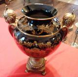 BLACK AND GOLD VASE / URN WITH FLORAL PATTERN AND 2 HANDLES