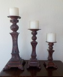 LOT OF 3 GRADUATED CANDLE STANDS WITH PILLAR CANDLES