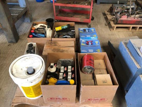 Pallet of Oil Filter, Oil, and Blue Def