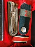 Box with Wehrmacht shoulder epaulets, Iron Cross 2nd Class ribbon