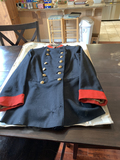 Blue double breasted frock coat with red cuffs and collars