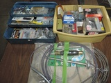 Lot Of Screws And Nails With Metal Toolbox And Drain Snake