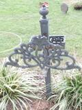 Free standing ornate metal Hose Holder