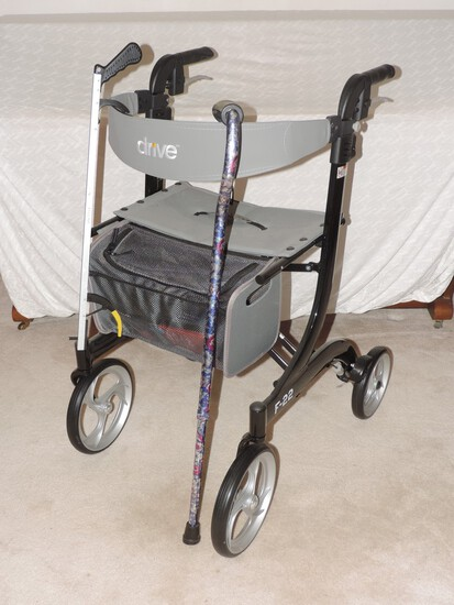 Extra Nice Drive Walker with Seat and Extra storage. Measures 36in by 20in by 24in