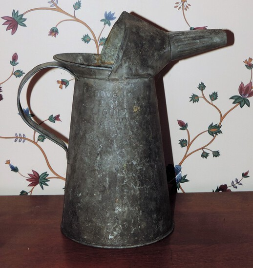 Antique metal oil can