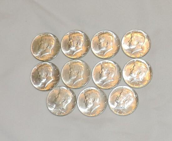 Lot of (11) AU 1964 Silver Kennedy Half Dollars