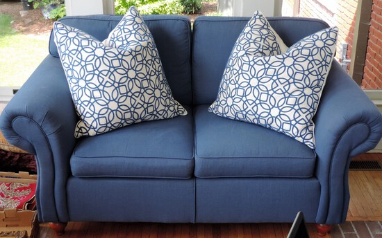 Loveseat with two throw pillows