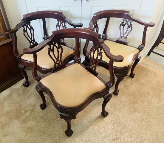 Three Hancock and Moore Corner Chairs