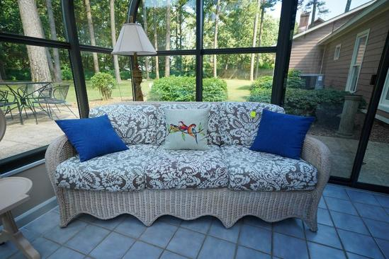 Wicker Couch With Decorative Throw Pillows