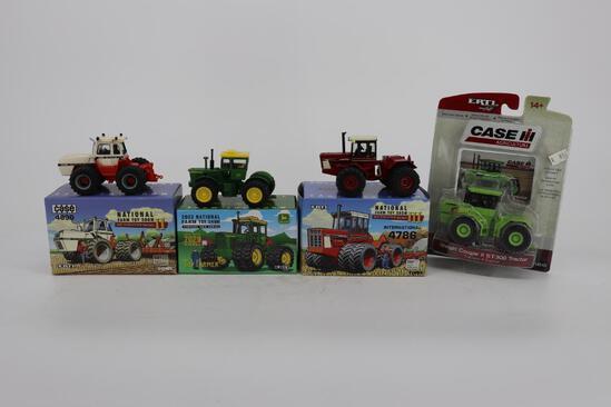 Three 1/64 4WD Tractors