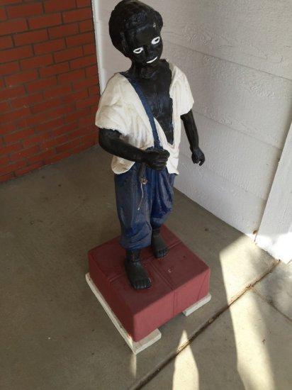 Sculpture of Boy In Overalls