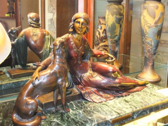 "Bronze Woman in Repose with Dog and Vessel on Marble Base, Plaque Reads ""V. H. Lanis"""