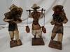 3 vintage paper mache figures bringing water/food