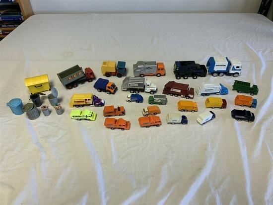 Lot of 24 Toy Garbage Trucks & 7 Garbage bins