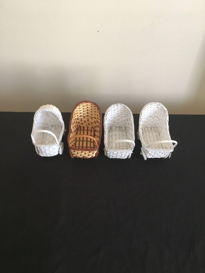 Four miniature baby buggies