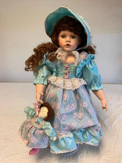 """Limited Edition 24"""" Porcelain Girl Doll with Blue Dress. Numbered 176 out of 2500"""