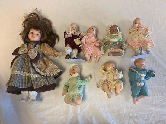 Lot of 8 porcelain Dolls with 7 Toddlers Dolls