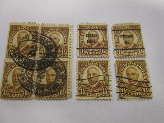 Eight historical 1 1/2 cent Harding canceled postage stamps
