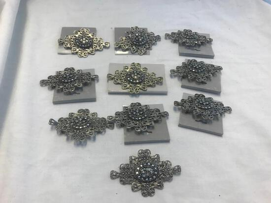 Lot of 13 Identical Silver-Tone Brooches