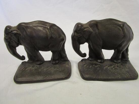 Vintage cast iron elephant bookends - trunk down