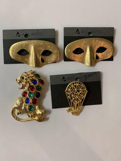 Lot of four vintage costume jewelry brooches