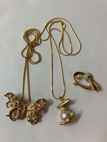 Lot of three vintage costume necklaces and brooch.