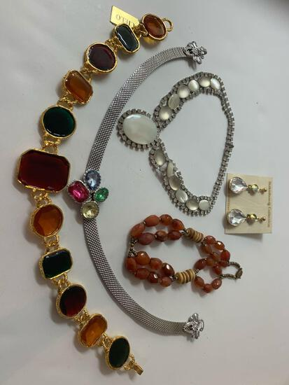 Lot of 4 various costume necklaces and 1 pair of earrings.