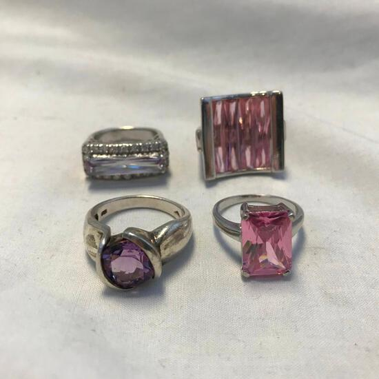 Lot of 4 Sterling Silver Rings with Pink or Purple Center Gems