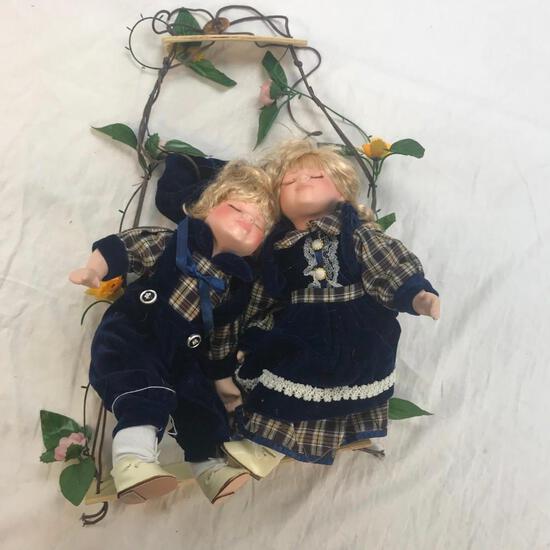 2 Porcelain Girl and Boy Dolls on Hanging Bench