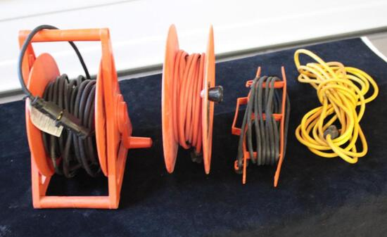 Lot of 4 extension cords with reels