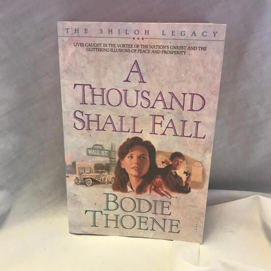 """""""A Thousand Shall Fall"""" Written by Bodie Theone Paperback"""
