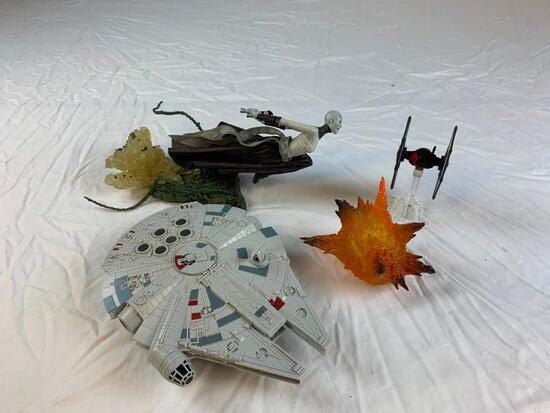 Lot of toy figures with Star Wars millennium falcon