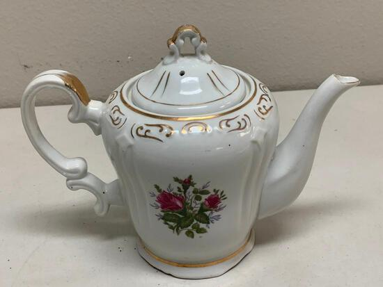 Vintage porcelain Musical Tea Pot with lid