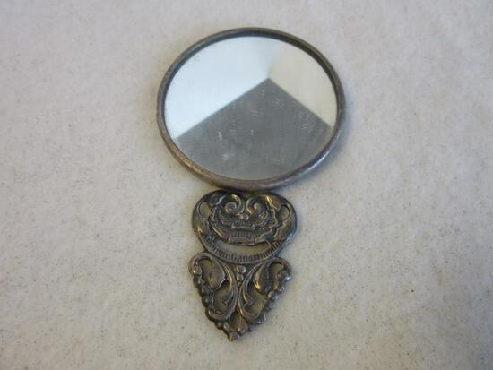 Small Sterling Silver Hand-Held Mirror with Relief Design on the Back (56.8 grams)