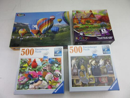 Lot of 4 Puzzles Ranging from 300-1000 Pieces