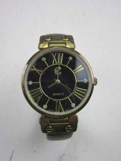 """ACCEL Quartz Stainless Steel Black and Gold Toned Roman Numeral Watch 2.5"""""""