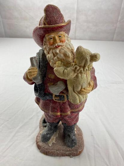 Glitter plastic Santa Fireman figure holding a child