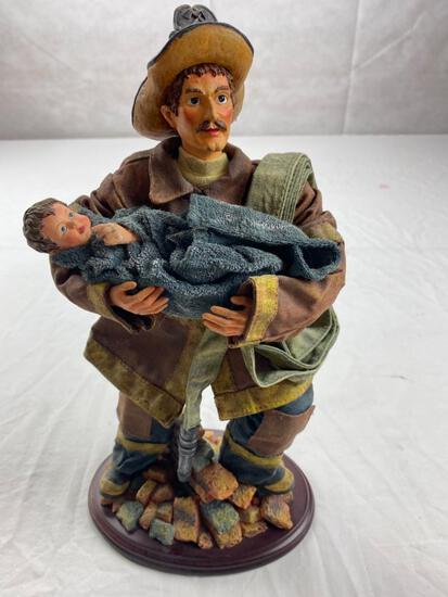 Cloth Fireman figure carrying small child