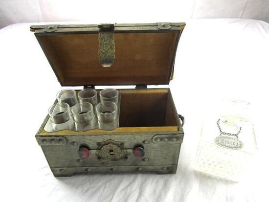 Replica wood treasure chest with brass accents, a glass decanter, and a set of 6 shot glasses