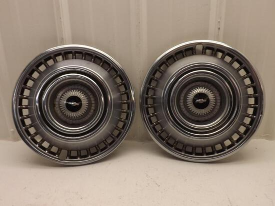 Two Chevy 14'' hubcaps from the 60s or 70s