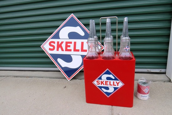 (1) Reproduction Skelly 6-Glass Jar Oil Bottles & Stand, (1) Reproduction Skelly Metal Sign & (1) Re