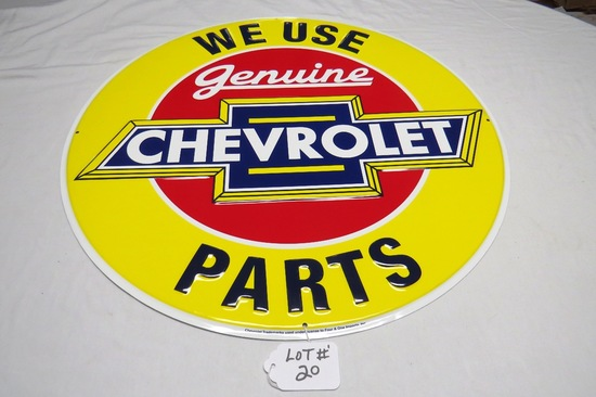 """We Use Genuine Chevrolet Parts Round Single Sided Reproduction Sign, 23 1/2"""" Diameter."""