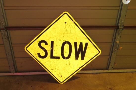 "SLOW Metal Sign, 24"" Square."