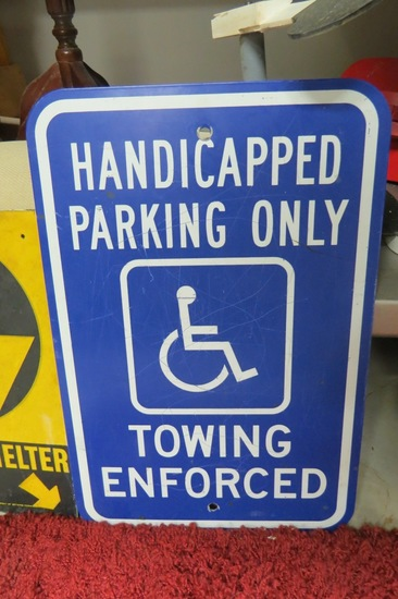 "Handicap Parking Metal Sign, 18"" Tall x 12"" Wide."