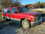 1989 Chevrolet Pickup with Topper.