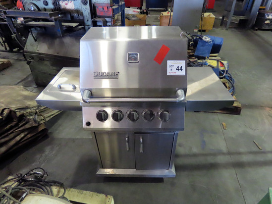 Ducane Stainless Steel Gas Grill with Propane Tank.