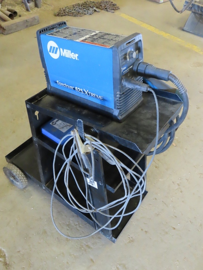 Miller Spectrum 625 X-Treme Portable Wire Feed Welder with Leads on Cart.